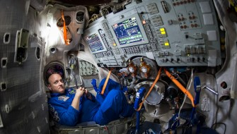 NASA Astronaut Scott Kelly is seen inside a Soyuz simulator at the Gagarin Cosmonaut Training Center (GCTC), Wednesday, March 4, 2105 in Star City, Russia. Kelly, along with Expedition 43 Russian cosmonaut Mikhail Kornienko of the Russian Federal Space Agency (Roscosmos), and Russian cosmonaut Gennady Padalka of Roscosmos were at GCTC for the second day of qualification exams in preparation for their launch to the International Space Station onboard a Soyuz TMA-16M spacecraft from the Baikonur Cosmodrome in Kazakhstan March 28, Kazakh time. As the one-year crew, Kelly and Kornienko will return to Earth on Soyuz TMA-18M in March 2016. Photo Credit: (NASA/Bill Ingalls)