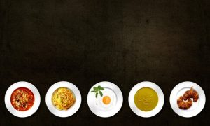 studio-shot-of-various-food-on-plates