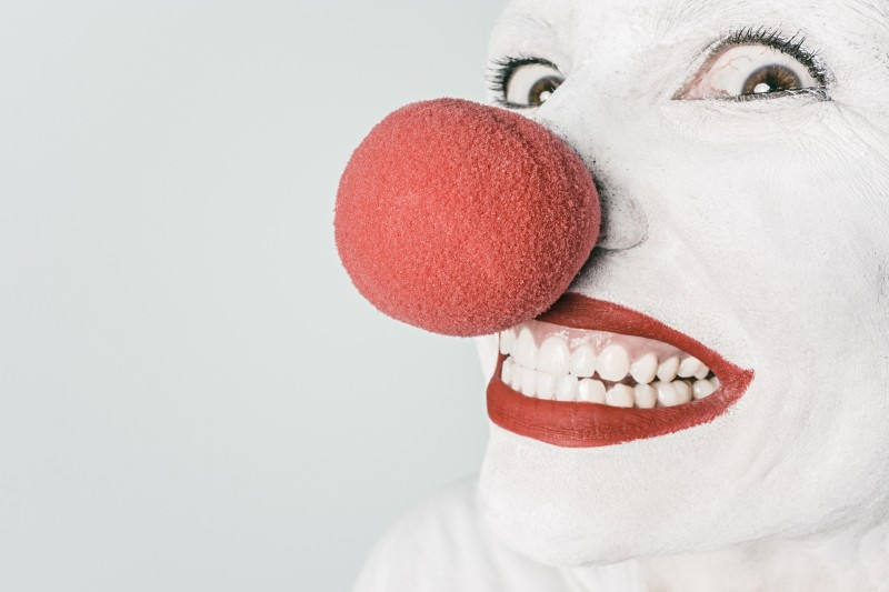 portrait-of-laughing-clown-with-red-nose